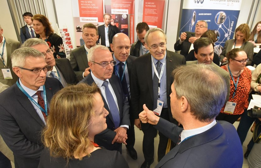 The Director of Agence Iter France, Jacques Vayron (far left), leads the traditional tour of the exhibition stands. The European Commission's Gerassimos Thomas, Deputy Director-General for Energy; mayor of Antibes Jean Leonetti; Fusion for Energy Director Johannes Schwemmer; Daniel Sfecci, representing the Nice-Côte d'Azur Chamber of Commerce and Industry; and ITER Director-General Bernard Bigot listen to representatives of the engineering group Assystem. (Click to view larger version...)