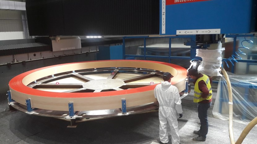 Dimensional measurements are performed before final machining. The five-metre-in-diameter, three-tonne components will be installed in sets of three at the top and bottom of the toroidal field coil structures to ''push back'' against deflection. (Three other rings will be manufactured as spares.) © CNIM (Click to view larger version...)