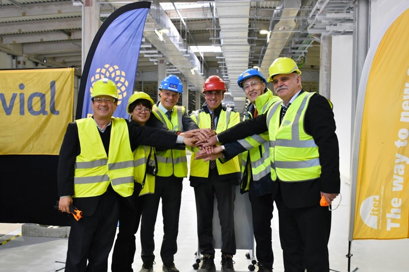 ITER's Bernard Bigot (second from right) takes ownership of three buildings from Fusion for Energy (represented here by Director Johannes Schwemmer, third from left). Also present were: ITER Korea head Kijung Jung; one of the deputy heads of ITER China, Min Wang; Joaquin Garcia of the European contractor Ferrovial; and the head of ITER Russia Anatoly Krasilnikov (from left to right). (Click to view larger version...)