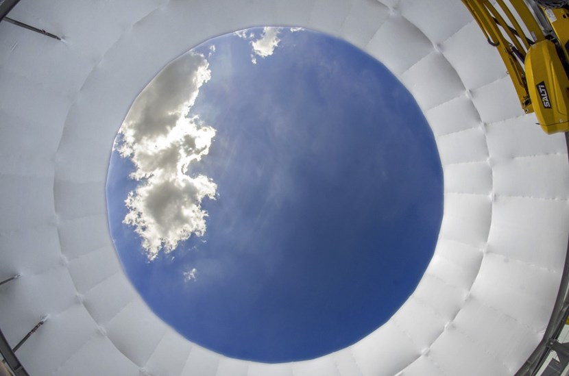 An unusual viewpoint of the protective cocoon that encases the cryostat lower cylinder, as air is being pumped into the 2,300 m³ volume to detect potential leaks. (Click to view larger version...)