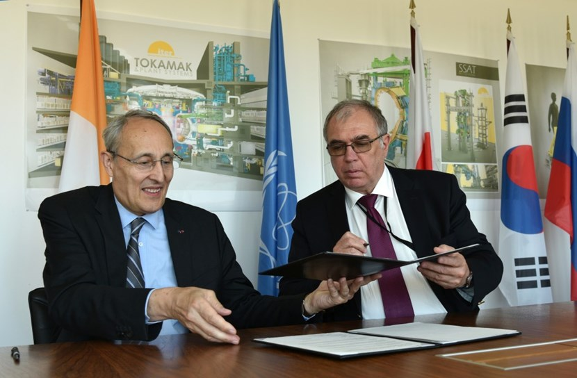 ITER Director-General Bernard Bigot signs the IAEA-ITER Practical Arrangements in the presence of Mikhail Chudakov, IAEA Deputy Director General and Head of the Department of Nuclear Energy. (Click to view larger version...)