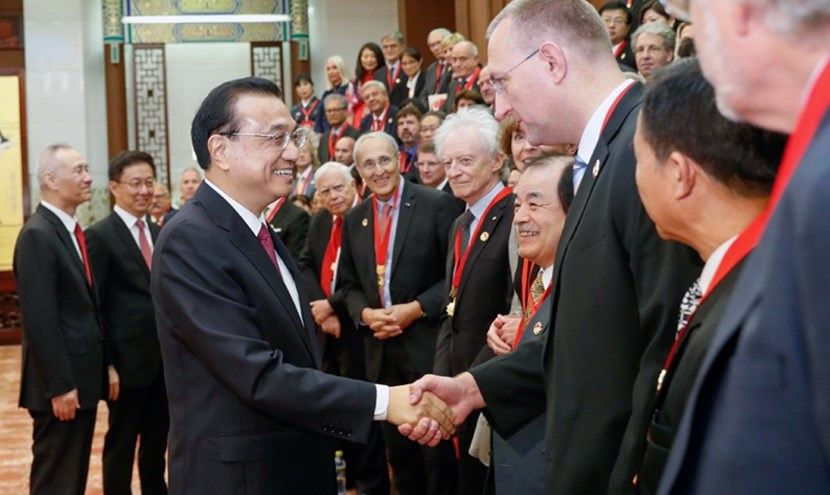 Premier Li congratulates each of the winners individually. (Bernard Bigot stands in the very centre of the image.) (Click to view larger version...)