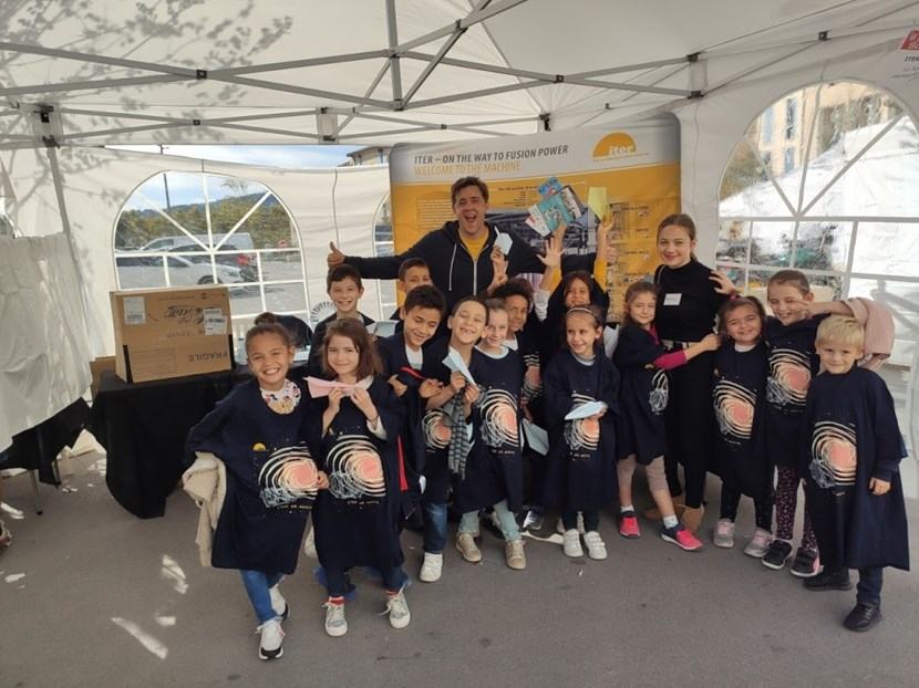 Fridays were reserved for school children, like this group that visited the ITER stand in Manosque. It may take them some time to grow into their ITER T-shirts ... (Click to view larger version...)