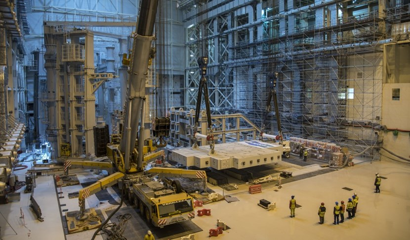 The 360-tonne megalith is lowered to the Assembly Hall floor. After six months hooked up first to one, then the other, of the sector sub-assembly tools (left), the test loads will be stored in laydown areas until called for use to commission the upending tool. (Click to view larger version...)