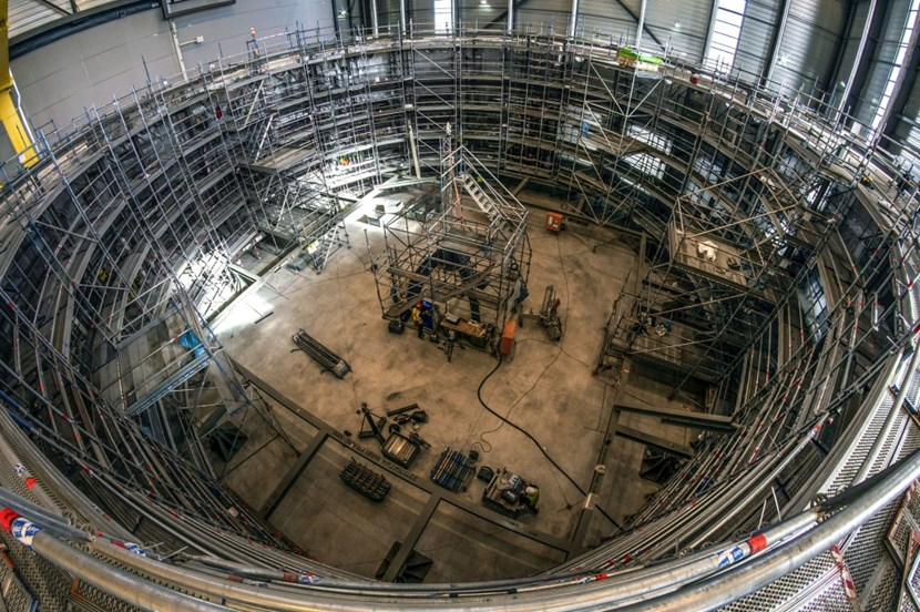 By the end of March, the 10-metre-tall, 430-tonne component, with a diameter of 30 metres, will be completely sealed away in a protective cocoon. (Click to view larger version...)