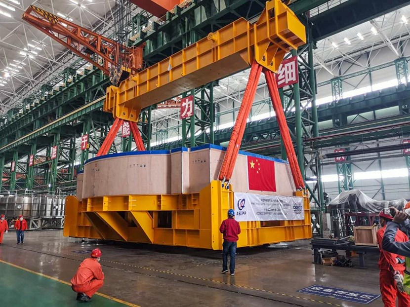The crated component and transport frame are lifted for removal from the ASIPP facility, where it was six years in the making. (Click to view larger version...)