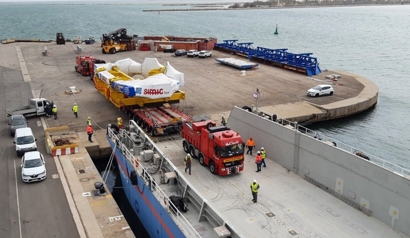 Secured onto its transport trailer, the load is transferred to the barge that will take it across the inland sea Étang-de-Berre. Delivery to the ITER site is expected in the early hours of 3 April. Photo DAHER (Click to view larger version...)