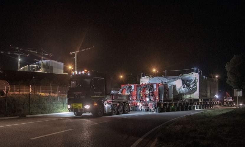 It is close to 2:00 a.m. and the journey from the other side of the world is almost over. Framed against the backdrop of the Tokamak Complex, the convoy will now take the heavy-haul road to the construction platform. (Click to view larger version...)