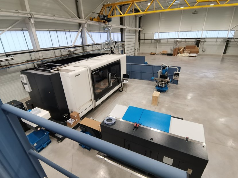 The new TAC2 machining workshop, with a large CNC (Computer Numeric Control) machine that operates along three dimensions to produce 3D parts and two milling machines, one vertical and one horizontal. (Click to view larger version...)