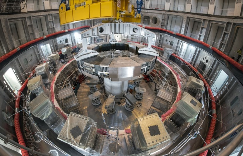 As PF6 slowly descends into the assembly pit, the eight-hour operation comes to an end. The coil will remain on temporary supports during the installation of all nine vacuum vessel sector sub-assemblies. (Click to view larger version...)