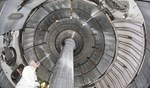 A researcher takes an upward view of the interior of NSTX, shown with the centre column. Copyright for all three photos: Princeton Plasma Physics Lab.