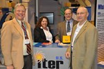 Holding up the ITER flag: Ned Sauthoff, Jamie Payne, Brad Nelson and Carl Strawbridge in front of the ITER stand at this year's AAAS conference.