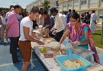 "On the occasion of ""Namaste India Day,"" ITER staff from India served around 500 of their peers from all over the world a tasty sample of traditional Indian cuisine."