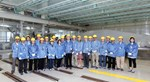 Here, in Mitsubishi Heavy Industry's Futami facility, the first toroidal field coil will be wound and integrated. Pictured: participants to Unique ITER Team activities in Japan in June.