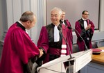 "Director-General Motojima had donned the purple toga of  professors, to which university Vice-President Denis Bertin attached the traditional ""ermine sash"". Professors André Thévand and Sadruddin Benkadda are in the background."