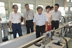 A team from the Chinese Domestic Agency, led by Director Luo Delong (centre), witnesses the welding of the dummy conductor.